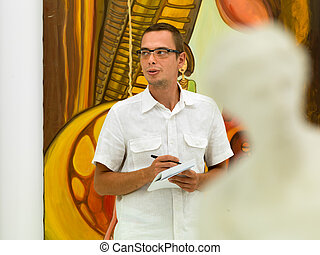 art collector at exhibition opening - young caucasian man...