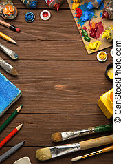 art concept and paint brush on wood background