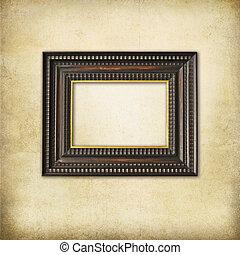 Art deco wooden empty frame on  a grunge background