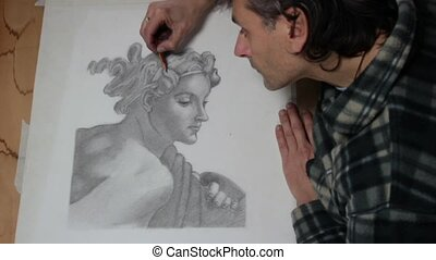 art drawing - artist making a pencil drawing