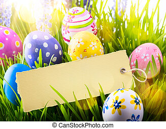 art Easter Background with easter eggs and spring flowers