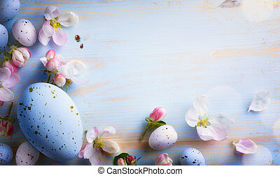 art Easter background with Easter eggs and spring flowers.