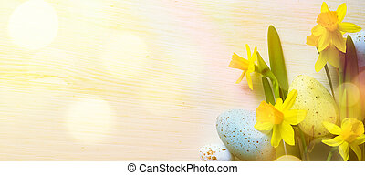 art Easter Background with easter eggs and yellow spring flowers