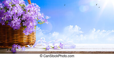 art Easter background with spring flowers a blue sky background