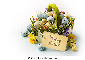 art Easter eggs basket on wooden background
