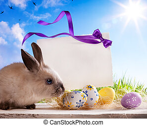art Easter greeting card with the Easter bunny and Easter eggs