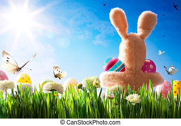 art  Easter teddy bunny and Easter eggs on green grass