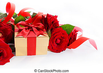 art golden gift box and red roses on a white background