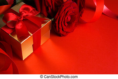 art golden gift box and red roses on a red background -...