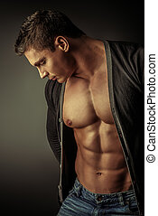 art handsome - Portrait of a sexy muscular young man posing...