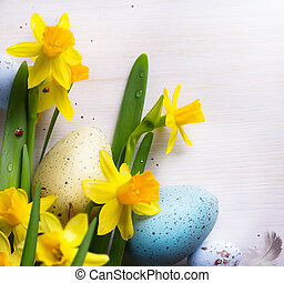 art happy Easter Background with easter eggs and yellow spring flowers