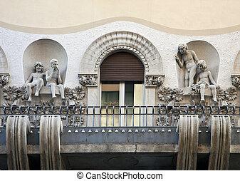 Art nouveau balcony with children figures