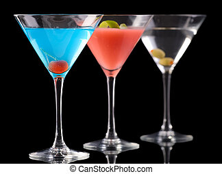 Art of cocktails. Betty Blue cocktail, Cosmopolitan cocktail and Dry Martini over black background.