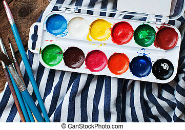 Art of Painting. Paint buckets on wood background. Different...