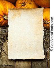 art orange pumpkins and paper sheet on wooden background - ...