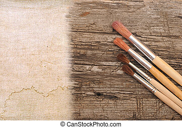 art paint brush on wood and canvas with space for text or...