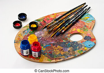 Art palette, brushes and paints.