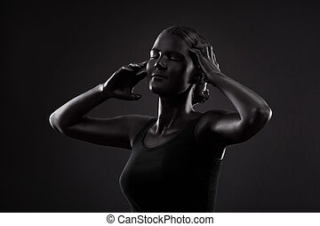art photo of a beautiful woman with black  make-up