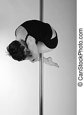 Art photo of a woman on the pole, black and white