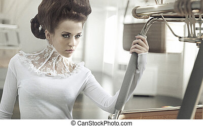 Art photo of adorable woman in retro interior