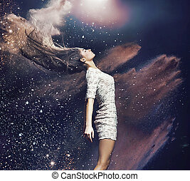 Art photo of the ballet dancer among colorful dust