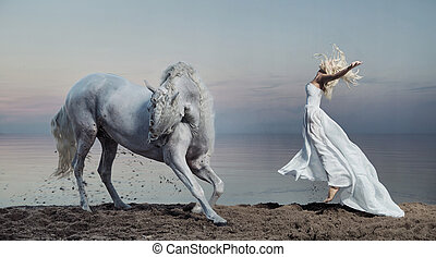 Art photo of the woman with strong horse