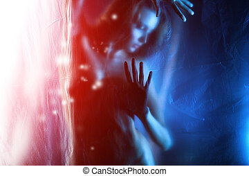 art photo - Vague silhouette of a beautiful naked woman.