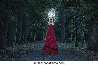 Art photo - stunning blonde beauty hodling a big lightbulb -...