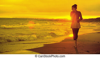 Art picture of woman, waves and sunset