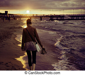 Art picture of woman with the sunset in the background