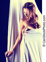 wrapped - Art portrait of a beautiful naked woman, wrapped...