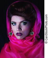 Art portrait of attractive girl brunette in a crimson cape closeup