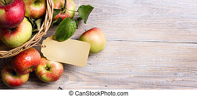 art Ripe red apples on wooden background