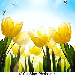 art spring floral background; fresh tulip flower on blue sky background