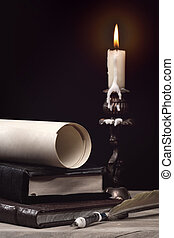Art still life with burning candle over old wooden desk