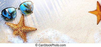 Art Summer Beach background with sunglass and starfish on sand; Tropical sea vacation concept