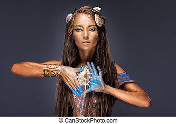 Art summer fashion portrait, girl holding seashell , golden skin makeup