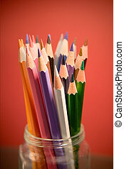 Colored pencils in a glass jar
