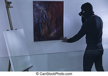 Art thief with flashlight