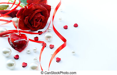 art valentines greeting card with red roses petals and  jewelry heart  isolated on white background
