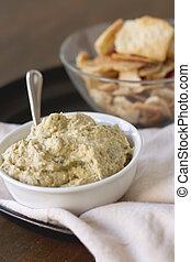 Artichoke Hummus - Artichoke hummus with pita chips on a ...