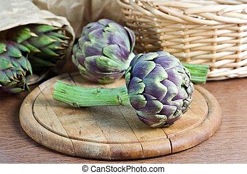 artichoke on wood table closeup