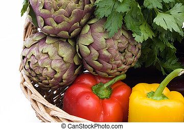 Vegetables - Closeup of basket with artichokes, eggplants, peppers and parsley.