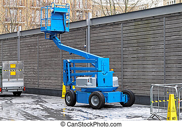 Articulated boom lift - Articulating blue boom lift for...