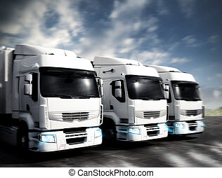 Articulated trucks - Three white articulated trucks on the...