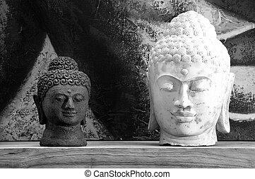 Artifact - Heads statue of Buddha, one white and one black.
