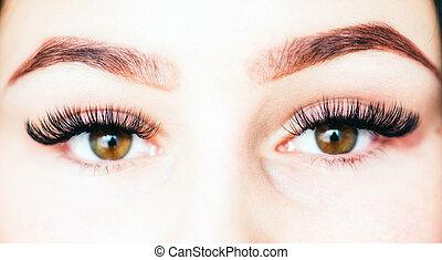 Artificial 4D lashes. eyelash extension procedure