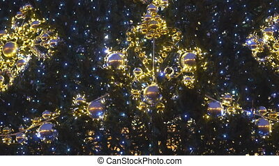 Artificial Christmas tree with garlands and balls.