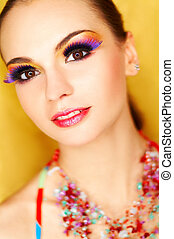 Portrait of attractive beautiful young sexy woman with artificial eyelashes and beautiful makeup