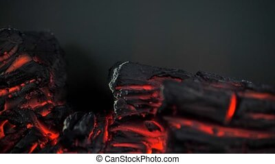 Artificial fireplace close-up, imitation of fire, coal in ...